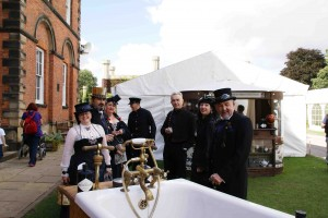 A group of steampunks at the Asylum gather around a bathtub of gin