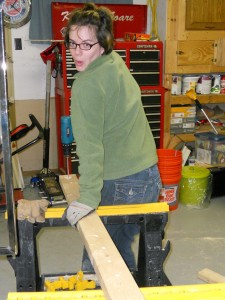 Girl posing using power tools
