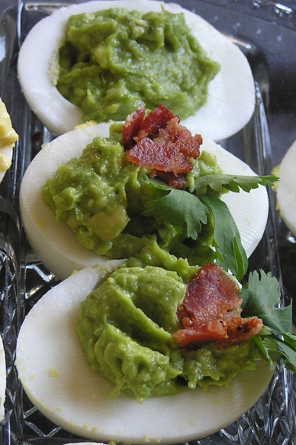 Deviled Eggs made with avocado bacon and devils cut bourbon